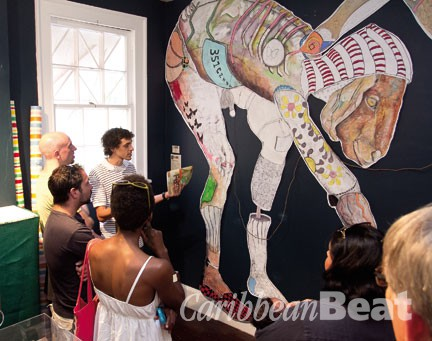 """Steven Schmid speaks to guests on the transforming Spaces Art Tour 2012 about his piece """"Geanexperiment"""" on display at Doongalik Studios Art Gallery. Photograph by Dominic Duncombe/ Stop Motion Productions"""