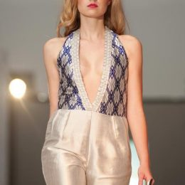 Silver and ultramarine blue diamond jumpsuit with woven trim details. Photograph by Bernado Neri