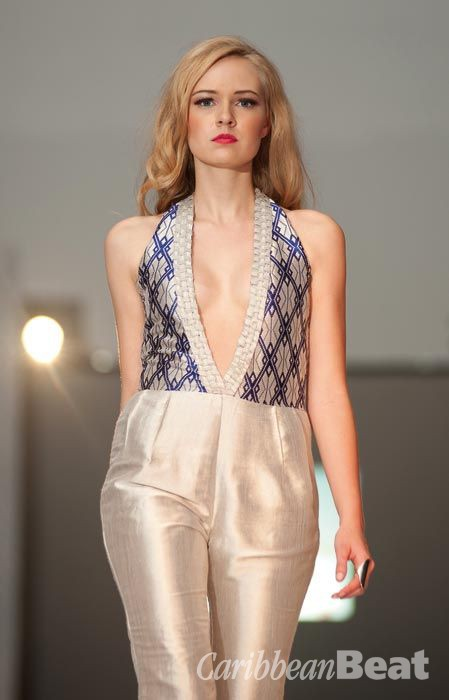 Silver and ultramarine blue diamond jumpsuit with woven trim details. Photograph by Bernado Neri