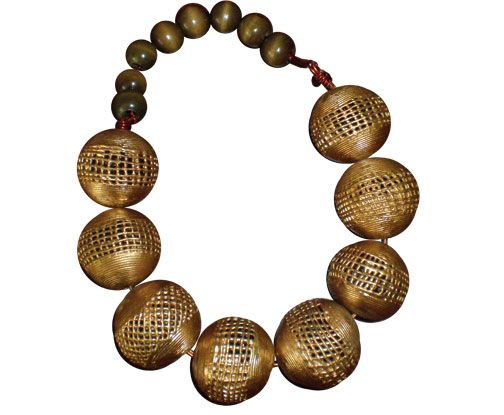 Brass and more brass; gold-coated wooden beads, threaded with copper wire for stability, and finished with a handmade clasp