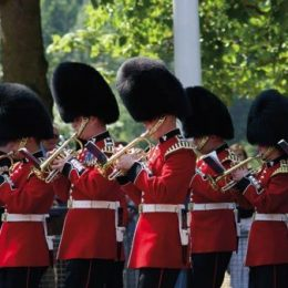 The Band of the Grenadier Guards plays outside Buckingham Palace during the changing of the guard