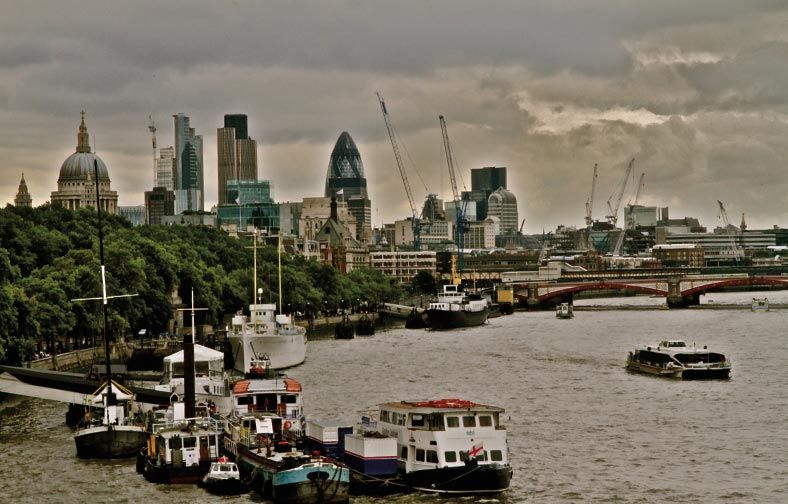 The Thames with St Paul's Cathedral and the buildings of East London in the background. Photograph by Kito Johnson