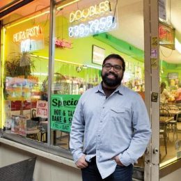 Ian Harnarine outside a doubles shop in New York City. Photograph by Elizabeth Harnarine