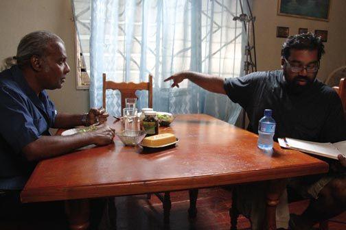 Errol Sitahal goes over the script with Harnarine on set. Photograph courtesy Ian Harnarine