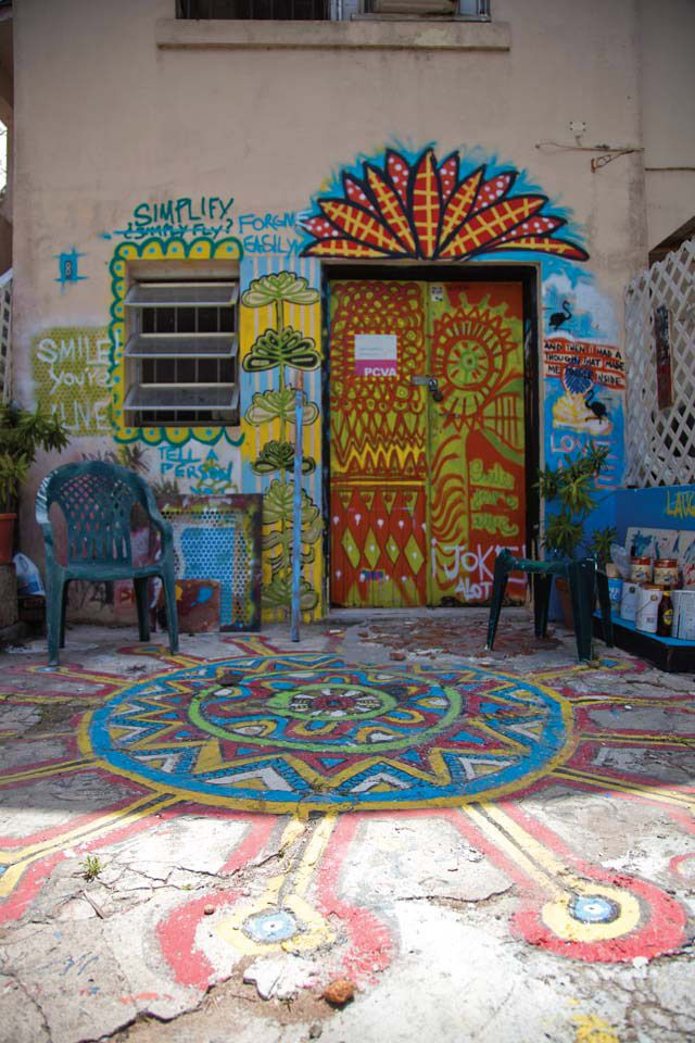 A  courtyard at Nassau's Popopstudios shows traces of the handiwork of its community of artists. Photograph by Nadia Huggins