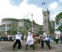 """BLS Barbados Landship performing the """"maypole"""" manoeuvre in National Heroes Square, Bridgetown, in the early 2000s. Photograph by Mike Toy"""