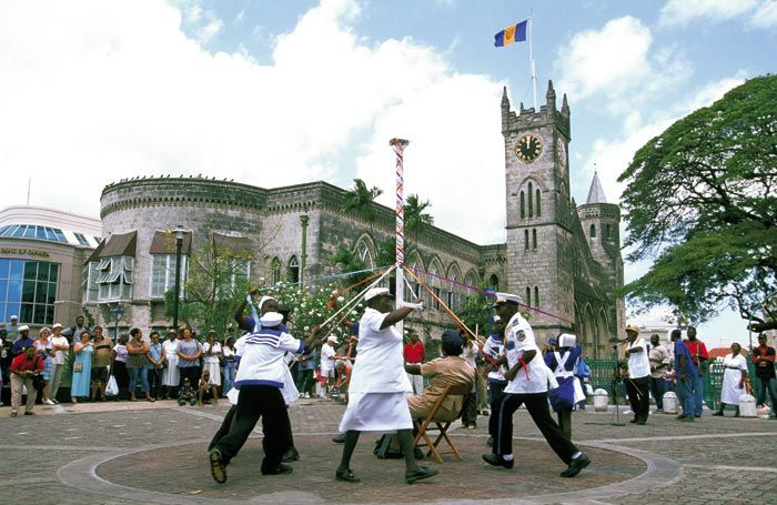 "BLS Barbados Landship performing the  ""maypole"" manoeuvre in National Heroes Square, Bridgetown, in the early 2000s. Photograph by Mike Toy"
