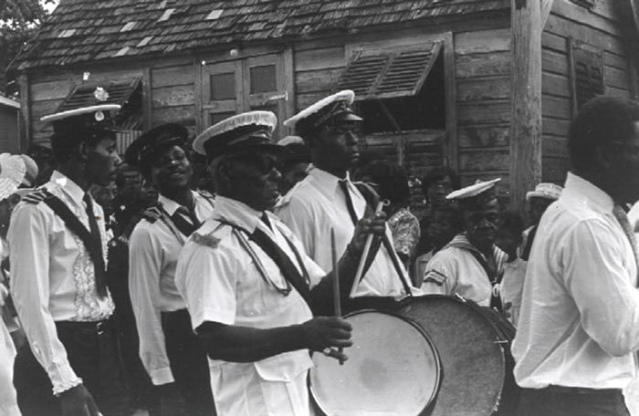 Landship tuk band parading at a funeral, 1973. Photograph courtesy the Barbados Government Information Service