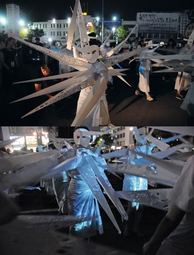 Volunteer masqueraders wore costumes featuring stylised bolts of energy. Photograph by Akiko Ota/ Marlon Griffith