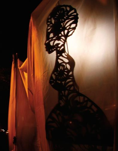 For A Walk into the Night, created at the 2009 Cape Town biennial, participants carried filigree silhouettes through the streets. Photograph courtesy Mark Wessels/ Marlon Griffith