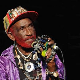 "Jamaican producer Lee ""Scratch"" Perry gets festive. Photograph by David Corio"
