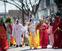 Costumed as Hindu deities, Phagwah celebrants parade down Liberty Avenue in Richmond Hill. Photograph by Evan Sung