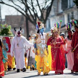 Costumed as Hindu deities, Phagwah celebrants parade down Liberty Avenue in Richmond Hill. Photograph by Evan Sung