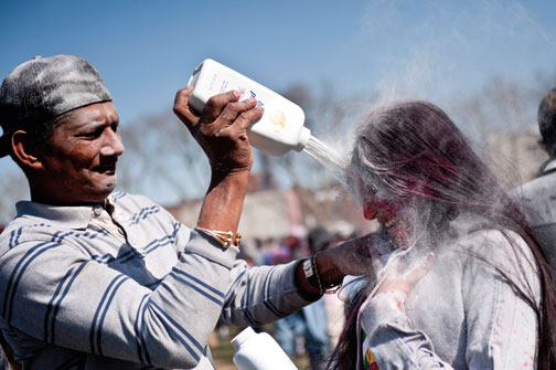 Talcum powder is a handy substitute for the more traditional gulal, the coloured powder sprinkled by Phagwah celebrants, or deep purple liquid abeer. Photograph by Evan Sung