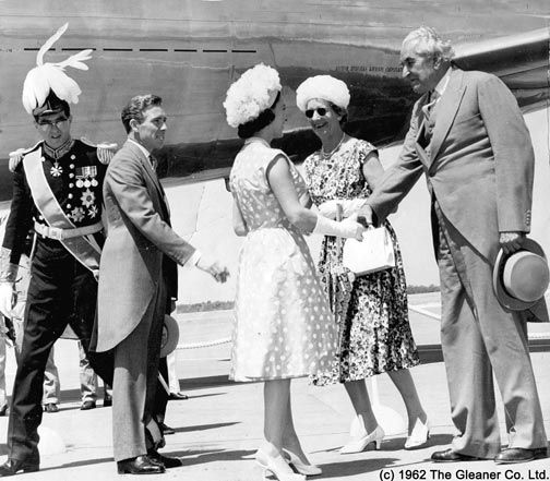 Jamaica's new prime minister, Alexander Bustamante, greets Princess Margaret on her arrival from London on August 3, 1962. Her husband Lord Snowdon (in the morning coat) awaits with outstretched hand. At extreme left is Governor Kenneth Blackburne. Photograph by the Gleaner Company Ltd (1962)