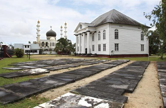 Neve Shalom, with relocated tombstones from one of Paramaribo's two Jewish cemeteries in the foreground. Photograph by Roy Tijn