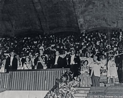 Guests in the main stand at the National Stadium rise at midnight in salute to the Jamaica National Flag as it is raised. Photograph by © the Gleaner Company Ltd (1962)