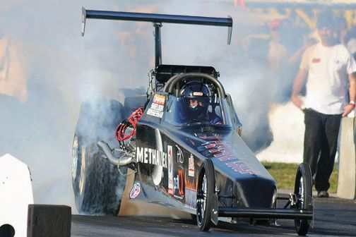 Bissessar performs a burnout in his 2011 Ironman chassis top fuel dragster. Photograph by Narend Sooknarine – ZORCE Magazine