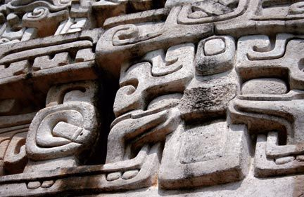 El Castillo's stucco friezes depict Mayan gods. Photograph by Adam Derewecki / shutterstock.com