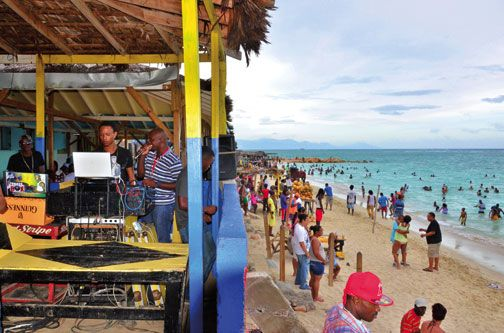 A busy Sunday at Hellshire, Kingston's most popular beach. Photograph by Otis Gilling