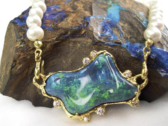 Australian opal naturally cut and set in gold with diamonds and pearls. Photograph courtesy the Goldsmitty