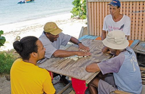 A game of dominoes helps while away a lazy afternoon. Photograph by Orlando Romain