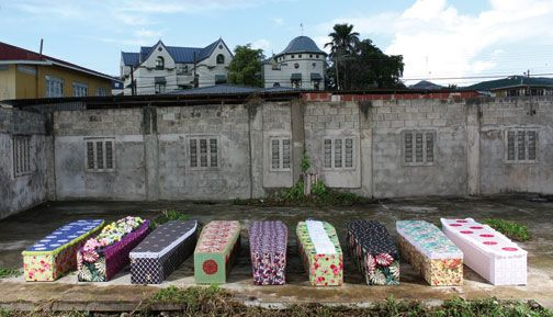 Decorated coffins created for 9 of 219 (2011), a site-specific performance work at Alice Yard, Port of Spain, Trinidad. Photograph courtesy Alice Yard/Rodell Warner