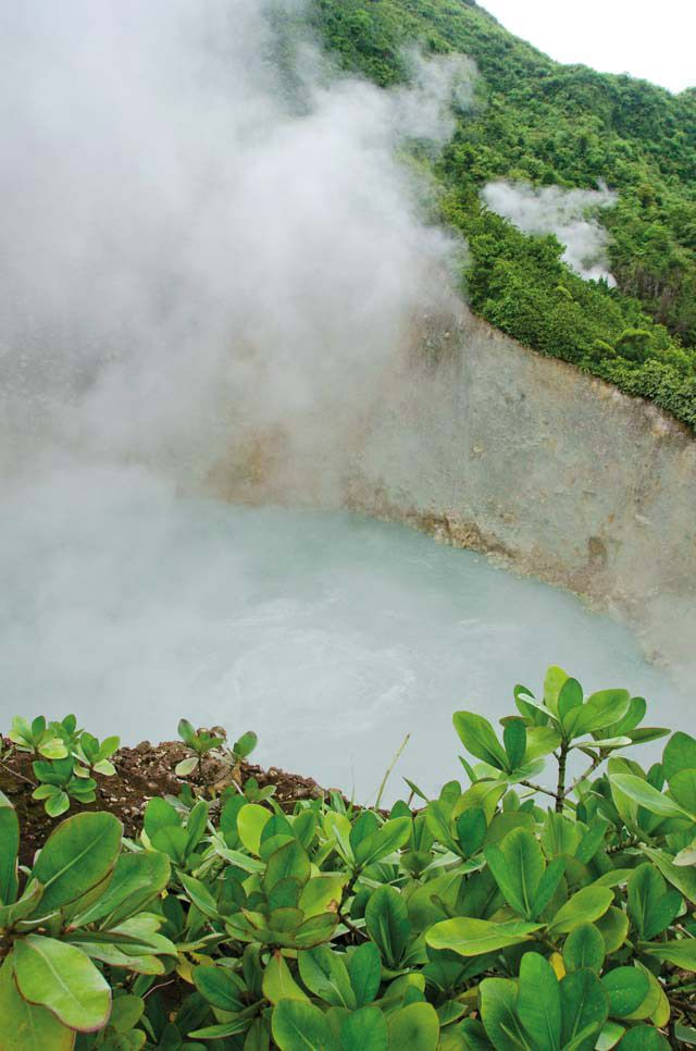 The grey waters of Dominica's Boiling Lake are heated by an underground chamber of magma. Photograph by Images Dominica