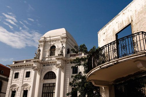 The Palacio Municipal houses a history museum, while a neighbouring building awaits restoration. Photograph by Tito Herrera