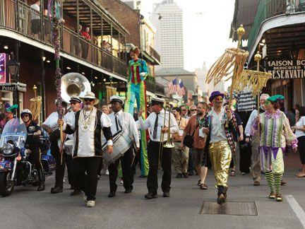 Bourbon Street parade at Mardi Gras. Photograph by Comso Condina