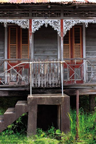 This house in San Fernando, south Trinidad, has been torn down since it was photographed. Only the steps remain. Photograph by Chris Anderson