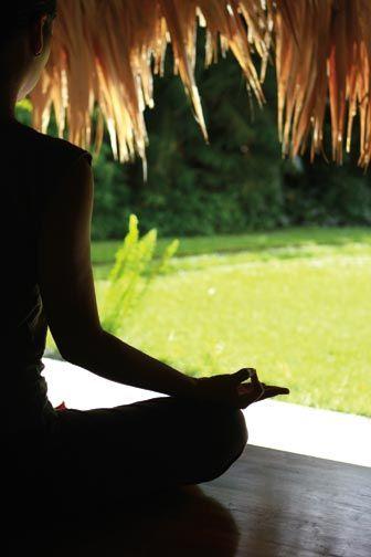 Practising yoga in the ajoupa at Kariwak Village, Tobago. Photograph courtesy Kariwak Village, Tobago
