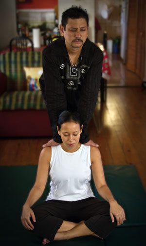 Dean Ammon practices an alternative branch of the yoga family tree, Thai yoga massage. Photograph by Edward Montserin