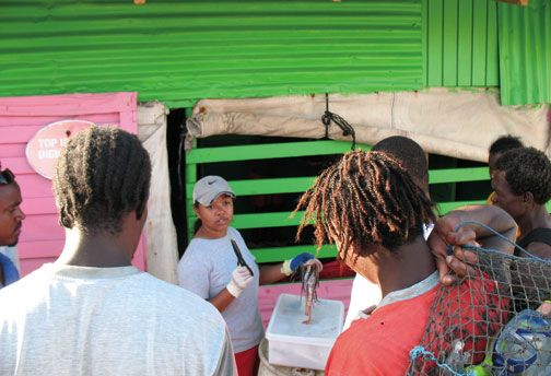 Briefing members of the fishing community as part of a lionfish survey. Photograph courtesy the Nature Conservancy