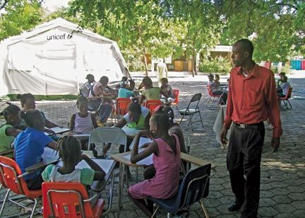 Children participate in art classes under the trees. Photograph by Erik Feely