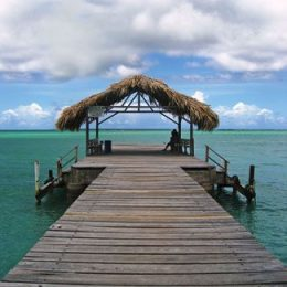 The quintessential thatched hut on the jetty. Photograph by James Fuller