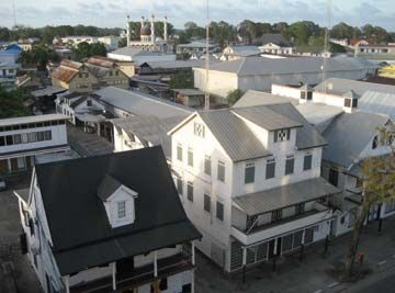 Sunset over Paramaribo's streets of wooden buildings. Photograph by James Fuller