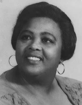 Louise Bennett-Coverly, poet, entertainer, and Jamaican national icon. Photograph the by National Library of Jamaica