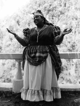Miss Lou in her trademark 'national costume'. Photograph courtesy Jamaica Information Service