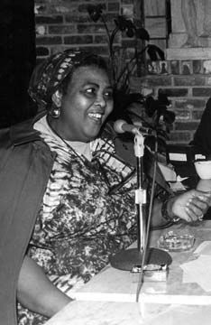 A young Miss Lou doing a live radio broadcast. Photograph courtesy the Jamaica Information Service