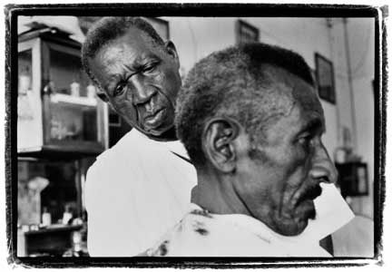 Clean Cut: At Barberia King`s, the king of barbers, Alfred Henry Smith, graduate of the Brooklyn School of Barbers. Photograph by Abigail Hadeed