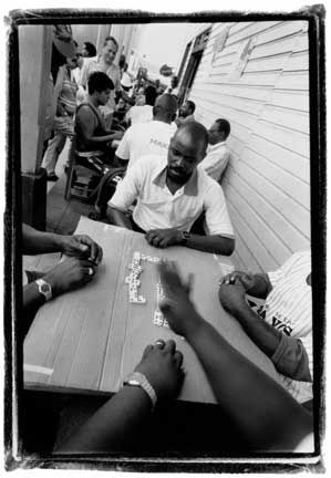 Dominoes Competition, Black Star Line: In Limón, Africa is celebrated in a big way on Afro Caribbean Day, August 31. Photograph by Abigail Hadeed
