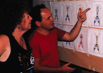 Toronto Islanders (Ann Buffery and Brad Harley) study Peter Minshall costume drawings at his mas` camp, 1987. Photograph by Gera Dillon
