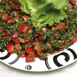 Tabbouli is an Arabic salad, made with chopped parsley, bulgur, mint, tomatoes, onions, and other seasonings. Photograph by Andrea De Silva. All dishes prepared by Lawrence of Arabia, Trinidad