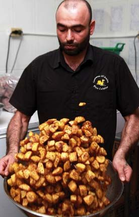 A panful of Arabic-seasoned potatoeos being tossed at Lawrence of Arabia. Photograph by Andrea De Silva. All dishes prepared by Lawrence of Arabia, Trinidad