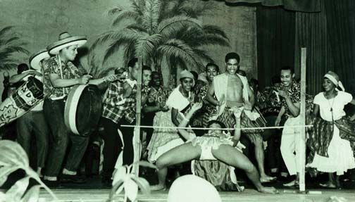 Limbo dancers perform in the cabaret section of London's first ever West Indian-style carnival. Photograph by Donald Hinds