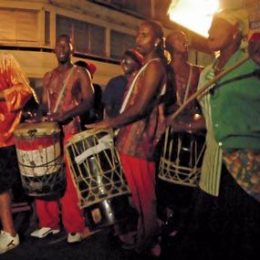 Chanting to the beat of drums, celebrants re-enact Canboulay. Photograph by Jeffrey Chock