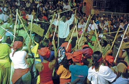 The crowd watches the pre-dawn performance on the streets of Port of Spain. Photograph by Jeffrey Chock