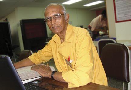 Shamsu Deen doing genealogy research at the National Archives, Trinidad. Photograph courtesy Shamshu Deen
