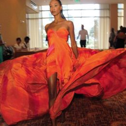 La Toya Woods rehearses her walk in the lobby at the Hyatt Regency in a Peter Elias gown. Photograph by Sean Drakes
